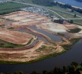 Island Park Development on the Red River in Shreveport, LA. ARE Consultants, Inc. performed planning and coordination with the Metropolitan Planning Commission for over $20,000,000 of roads, utilities, and marine construction.